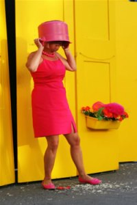 Lady in pink with bucket over head